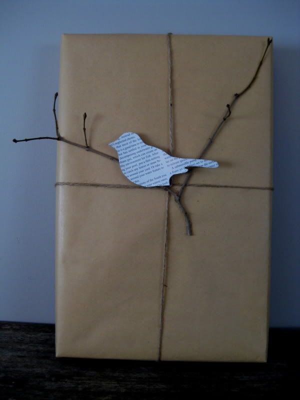 Love this newspaper bird on a twig! Could translate this to other items... Christmas wrapping