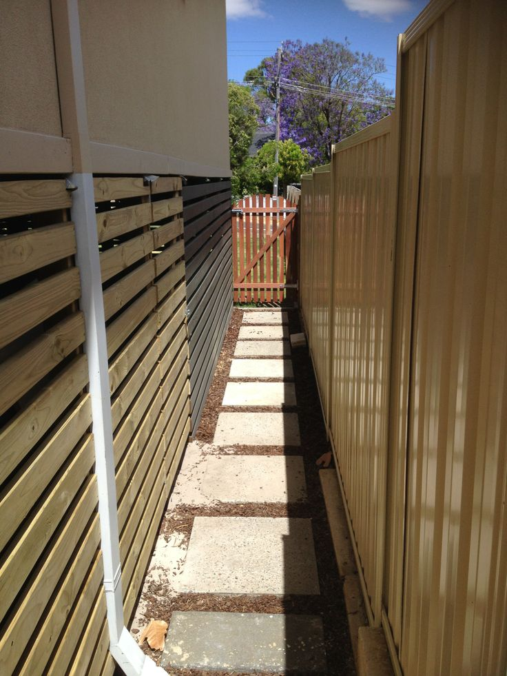 Timber slats plus lockable gate to create shed under the house, unpainted