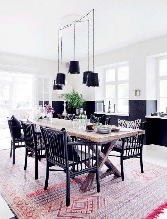 Traditional yet modern dining space with wood table and black chairs