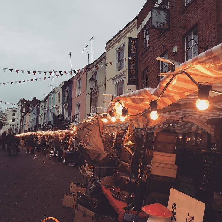 #Repost @katrinaphillipsinteriors  Portobello is lined with lights and stalls in the street for Paddington the movie. The whole street alive and full of Real Stuff. The way it ought to be Every Day. So it takes an art director to make Portobello real ? That's not impossible is it Kensington and Chelsea? A bit of quality control more stalls in the street .....they've even managed to Put Up Street Bunting to make it pretty.