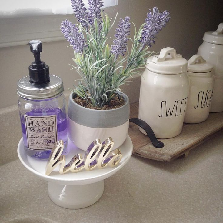 Kitchen sink display Rae Dunn canisters cake stand Mason jar soap lavender