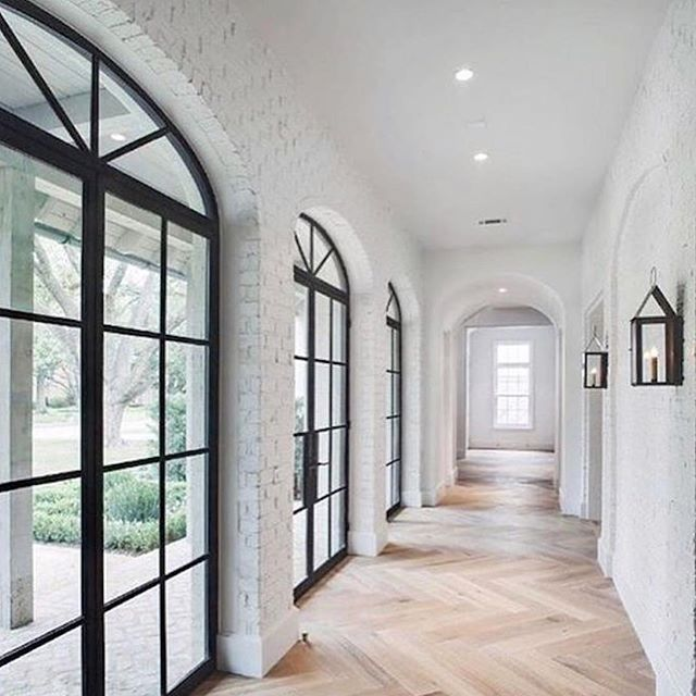 Perfect hallway: spatious and elegant. The wooden floors match perfect the with the large black framed windows.   via @beckiowens on Instagram