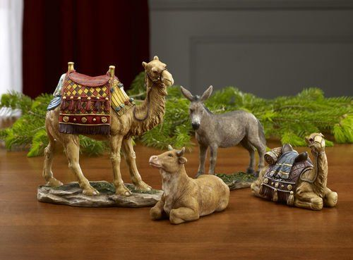 """Christmas Nativity Animal Figurines - 10 Inch Animals. Works with 10"""" Nativity Set. Ox Size: 3"""" x 5"""". Donkey Size: 4. x 4.5. Standing Camel Size: 6.75. x 6.5. Sitting Camel Size: 3.5. x 4.75. A donkey and ox attentively pay homage as smiling, brightly adorned camels approach. These intricately detailed animals complete the Real Life Nativity Creche 10"""" Set of figurines. Made of High Quality Polymer Resin."""