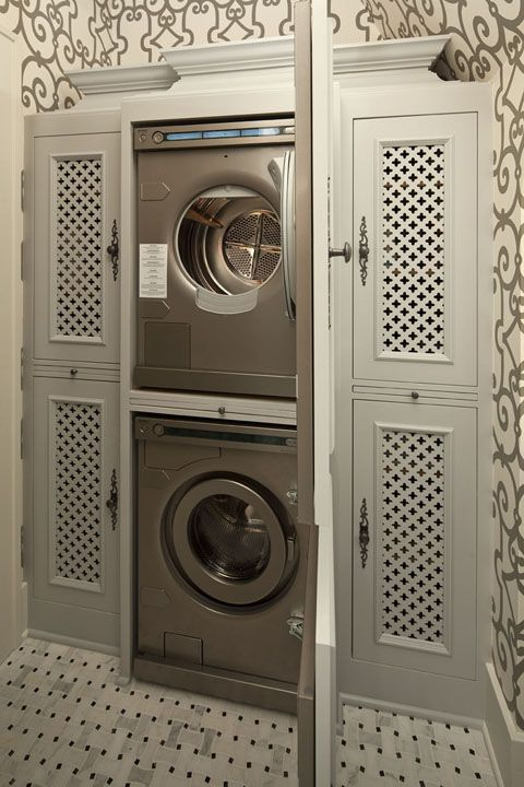 Laundry cabinet in hall, bathroom or laundry room.