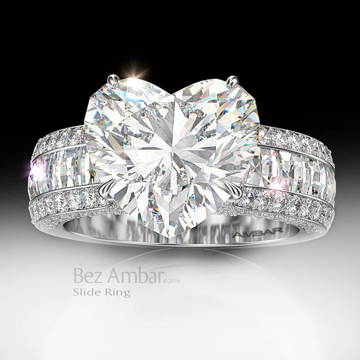 Bez Ambar's Slide ring with Blaze® diamonds and a heart center. #diamondjewelry #blazecutdiamonds #engagementrings www.bezambar.com