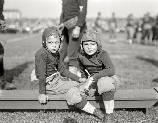"October 1922. ""Football."" Two little leatherheads at the Navy-Georgia Tech game in Annapolis."