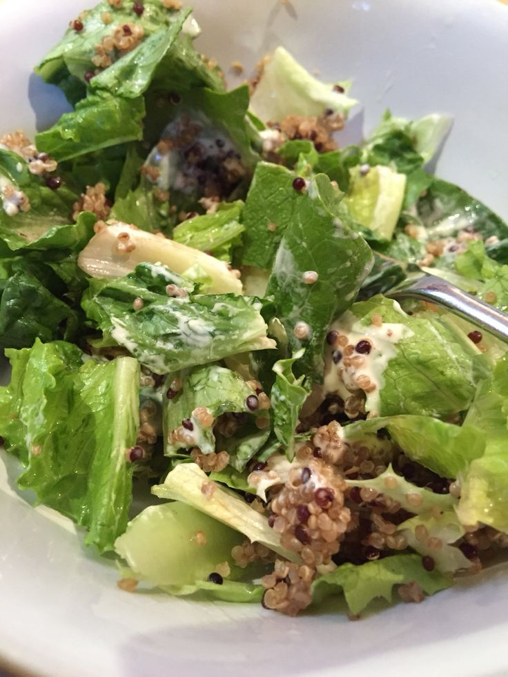 Green salad with a caesar dressing and quinoa