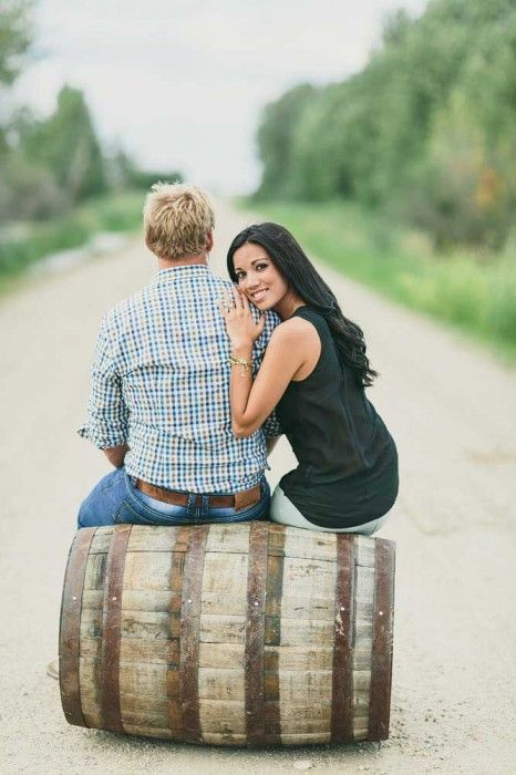 This wooden barrel works as a lovely prop for an engagement session. https://mjand.co/farmers-engagement-photography-rosthern-saskatchewan/