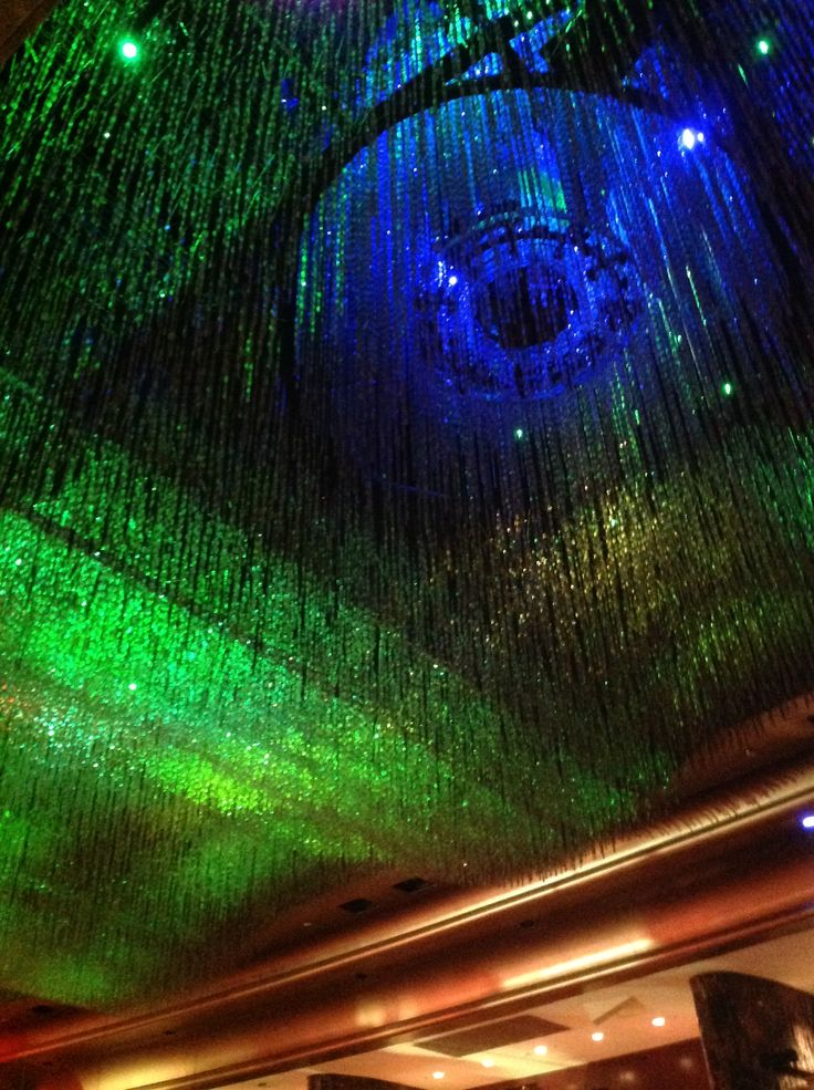 Different length crystals provide depth, texture and interest to create waves in this light installation in the atrium at Crown Casino, Melbourne.