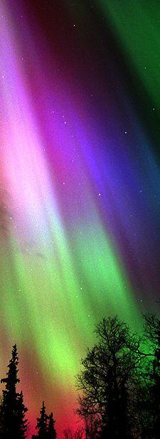 Colorful Aurora Borealis Over Finland By Finnish Tourist Board