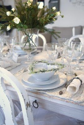 Holiday table settings—Add whatever bits of loveliness you'd like to create a mood you want to achieve: pine cones, vintage ornaments, flowers, a poem on a place card... French Larkspur