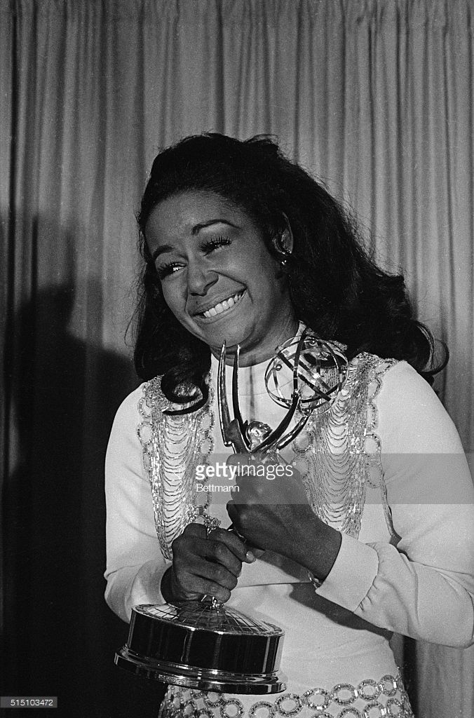 Actress Gail Fisher holding the Best Supporting Actress in a series Emmy she won for the series 'Mannix'.
