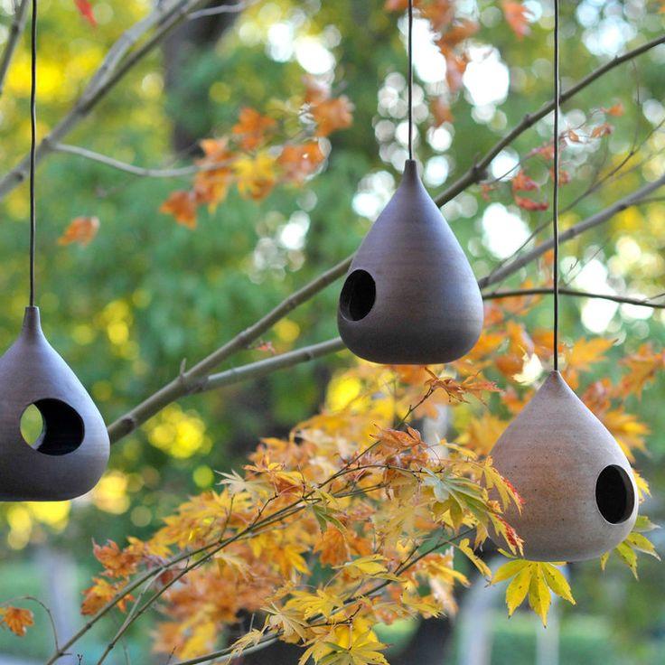Gorgeously sleek wheel-thrown clay bird feeders from potter Bob Dinetz.