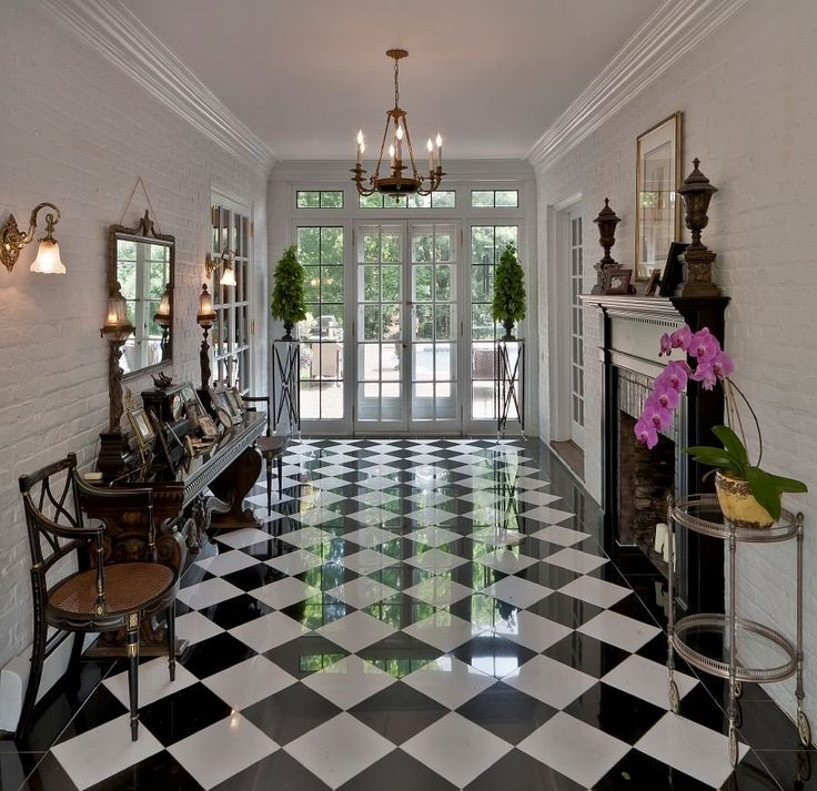 Checkered floor. For the classic, urban, or modern interior. #foyer #fireplace #design
