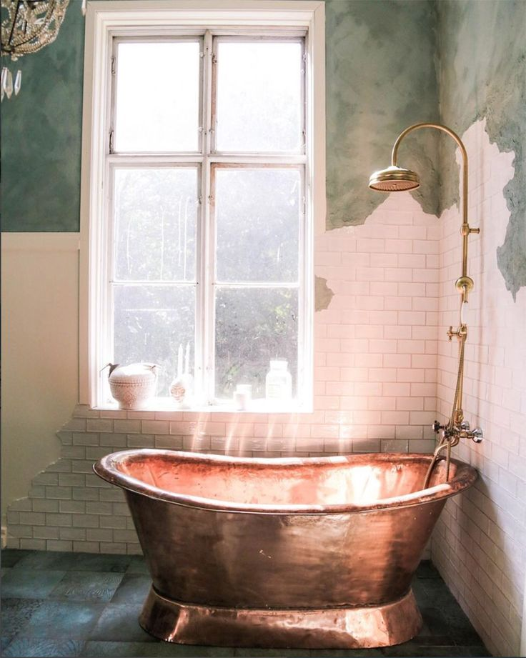 Copper bathtub, tiles and paint. Beautiful mix of materials. www.tiledesire.com