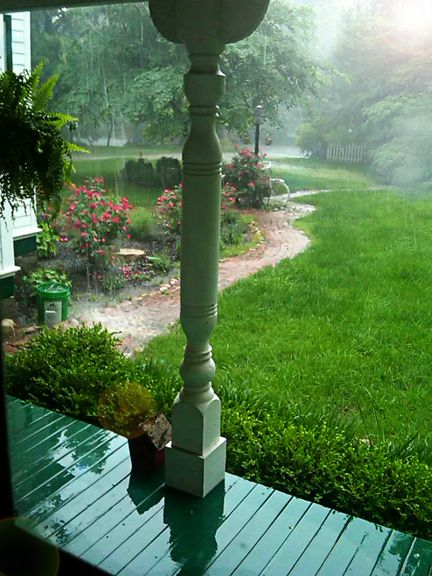 Sitting on a deep porch while it's raining admiring the turned porch post.