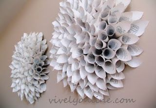 Wall art made of old textbook paper. #GreenWeddings