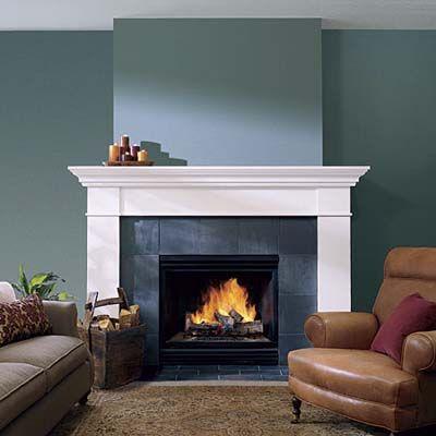 Slate. Build a false sticky out chimney and a really large fireplace?