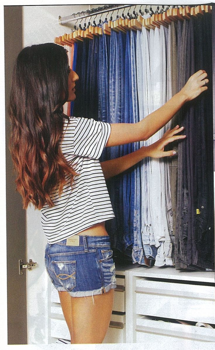 Hanging jeans in closet