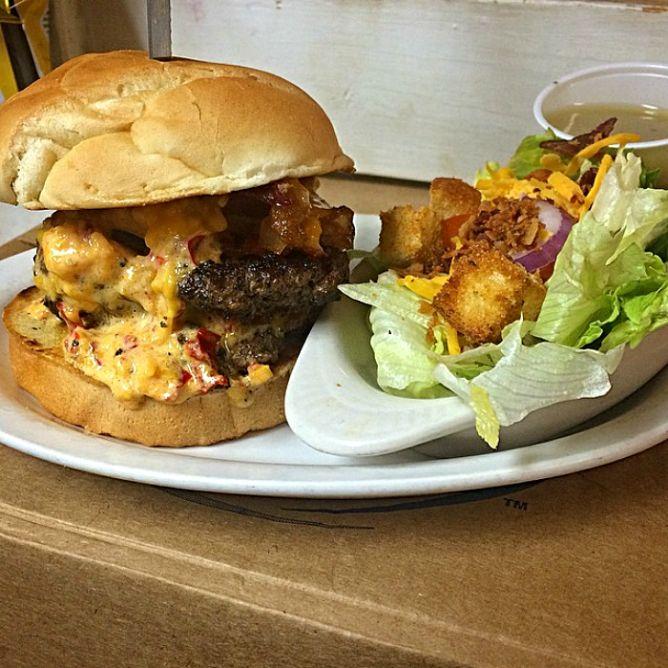 Tupelo Top Ten Bacon Pimento Cheese Burger | Courtesy of Blue Canoe