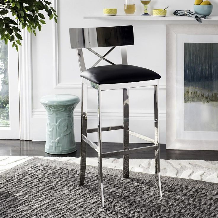 Safavieh Furniture FOX2034A - This modern bar stool is at the height of fashion. Inspired by London's legendary art deco bar, its polished stainless steel finish is as smooth as Bond's