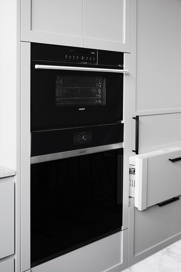 """<a href=""""http://www.subzero-wolf.com/"""" target=""""_blank"""">Wolf products</a>: Contemporary M Series Oven, Contemporary M Series Steam Oven, Integrated Warming Drawer and Contemporary Induction cooktop. <a href=""""http://www.subzero-wolf.com/"""" target=""""_blank"""">Sub-Zero products</a>: Fully integrated fridge with 2 freezer drawers"""