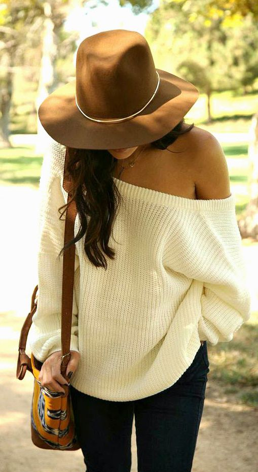 Andee Layne is wearing a white oversized off the shoulder sweater from NastyGal and the fedora is from Janessa Leone