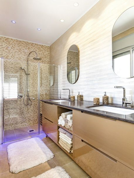 Warm earthy mosaic tiles hold a sense of style and elegance in your bathroom. Not to mention the shiny cabinets that elegantly melts all the beauty together