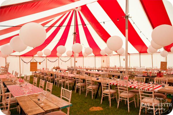 Striped wedding tent for a carnival circus wedding theme by Kat Forsythe Photography.