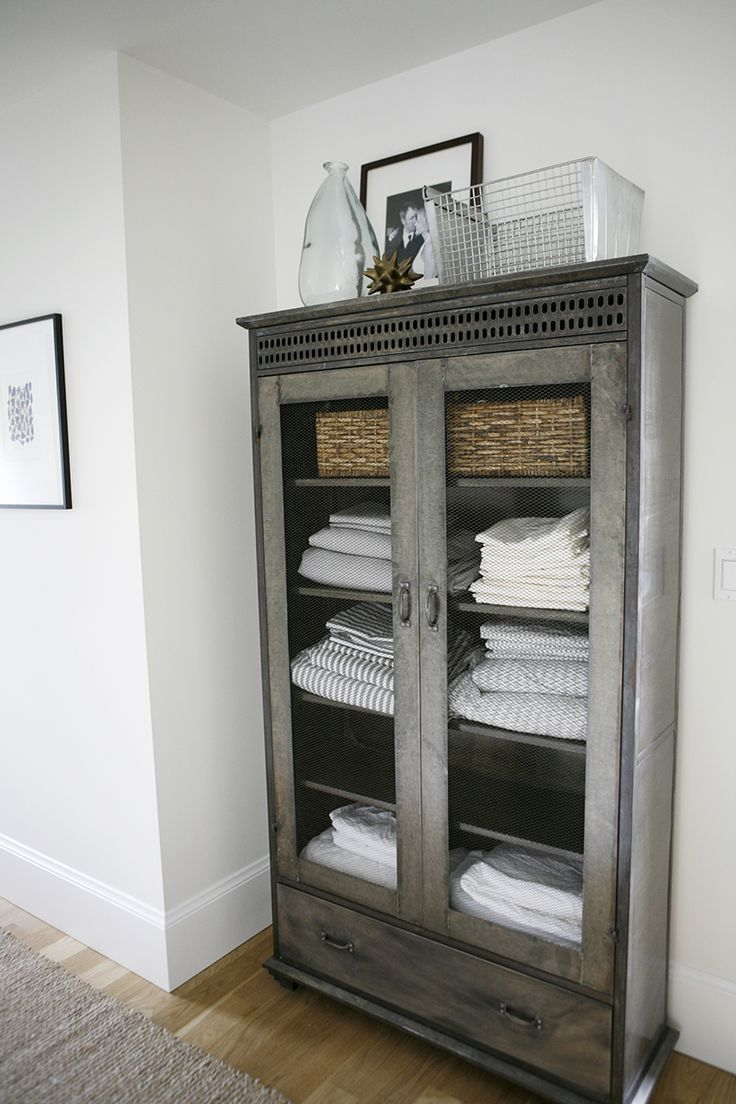 Baskets inside a cabinet is a great storage idea!  | Modern Farmhouse - H2 Design + BuildH2 Design + Build