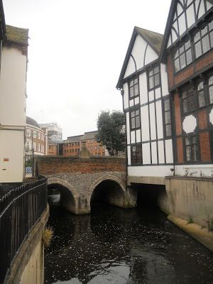 The Clattern Medieval Bridge that crosses the tiny tributary of Hogsmill, Kingston upon Thames, England, dates from 1293. The medieval name Claterynbrugge is thought to have been descriptive of the sound of horses crossing the bridge on the way to the busy Kingston market place.