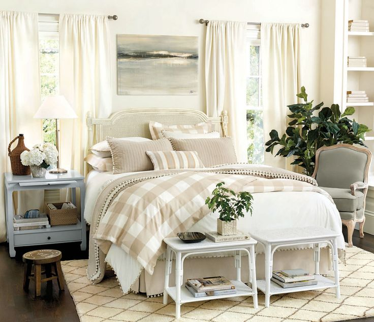 You can never go wrong mixing neutral bed linens and draperies. This look is polished, clean, and enduring.