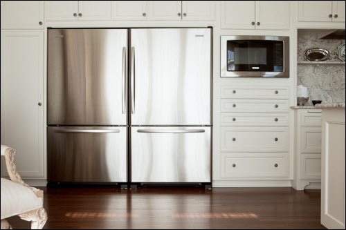 Condo Cabinets Built Around Double Fridge And Microwave