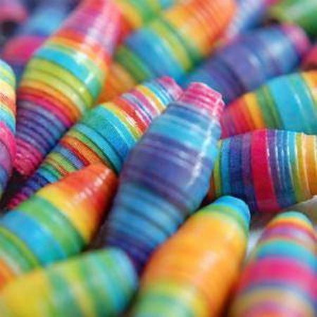 Paper Beads.  My Gramma used to make these with scraps of wallpaper.  The necklaces were awesome!