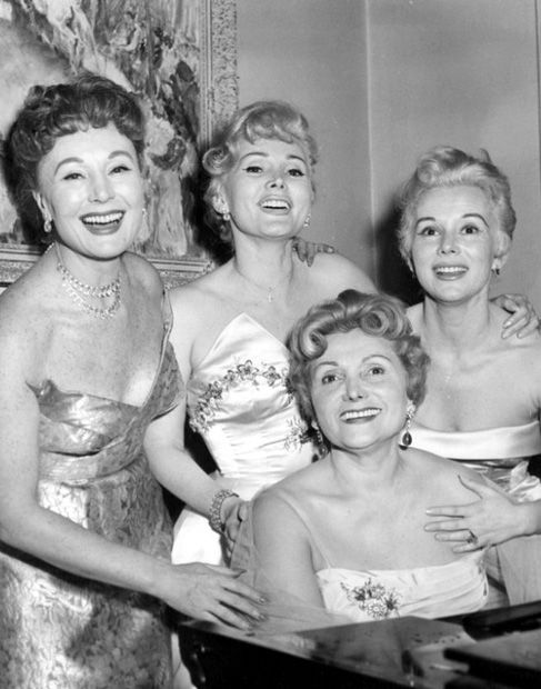 Jolie Gabor at piano in her NY home w  daughters Magda, Zsa Zsa & Eva / The Gabor sisters were 3 Hungarian-American actresses/ socialites: Magda (1915–1997), Zsa Zsa (b. 1917) & Eva (1919–1995) - born in Budapest, Austria-Hungary to Vilmos & Jolie Gabor. They moved to NY after WW2. Magda had played a small role in a Hungarian film pre-war, so Jolie & the girls moved to Hollywood to break into the film business. Zsa Zsa was the only one to have a child - C. Francesca Hilton (1947-Jan 5…