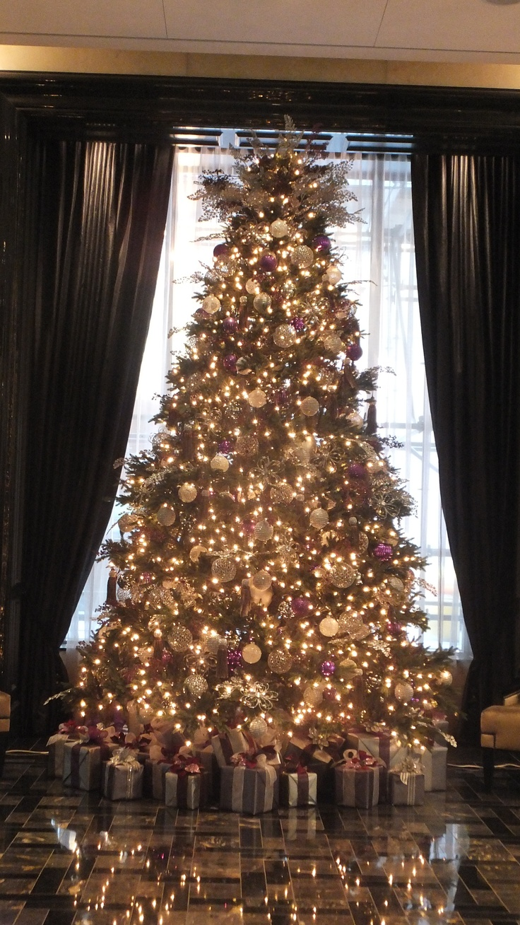 The tree at Trump Toronto glistening in the lobby.