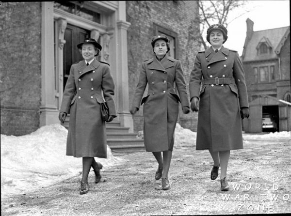 """This is a picture of women involved in a """"man's"""" job as police officers. It demonstrates how women are helping out during the war in ways they haven't been able to experience before. This is a credible source because it gives some information about the time period and is taken directly from the time period"""