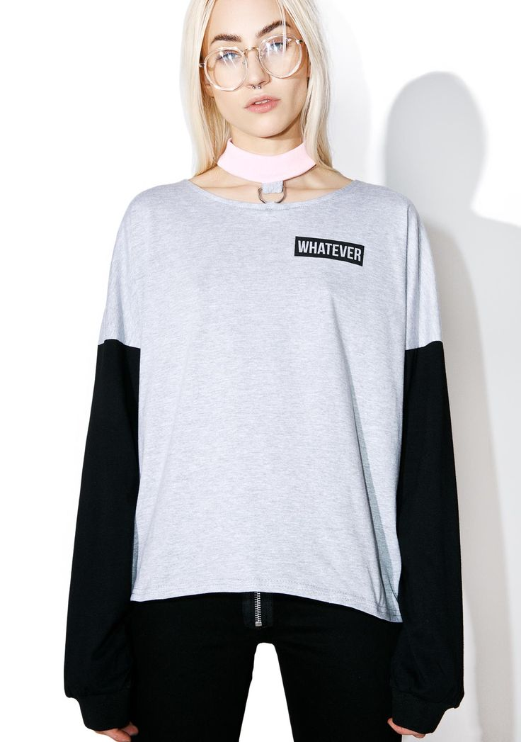The Ragged Priest Neutral Tee cuz whatever happens just….idk, I lost interest. This dope oversized tee features a comfy heather grey construction, contrasting black sleeves, attached baby pink choker, and applique on the chest reading 'Whatever.'