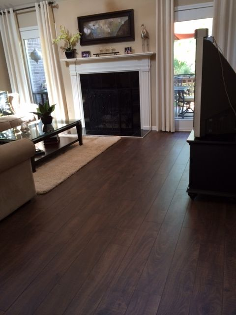 """The picture they have doesn't do it justice!! It's beautiful and it's perfect for pets. I have 3 cats that chase each other all the time and I see no scratches! Everyone who sees it comments on how beautiful it looks!"" (Aberdeen Garden Oak)"