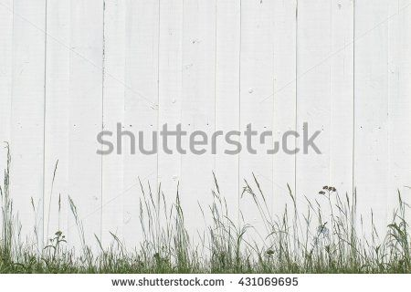 white wooden fence background over the grass - background for your design