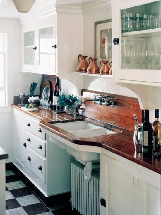 Stunning wood counters.  ooohhhh.  Recycled long leaf pine planks.   Clever clever people used a standard white cast iron sink and installed it to mimic a farmhouse sink.  This is how you get a big $ look on a budget.  Probably not for your house but I could do what's in this picture for peanuts out of the scrap in my yard.