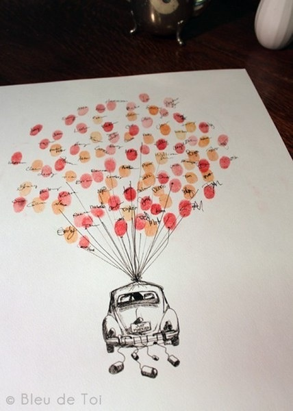 finger print guest book. Instead of a car it would be so cute to make it looks like the house on Up and then do different finger print colors as the balloons