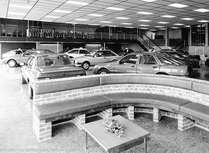"""1983 Ford dealership showroom. Note the Sierra Ghia, and the newly launched basic 3 door Sierra in the background. There is also the new Ford Orion, which was launched with the """"GL"""" trim as the entry level to the range."""