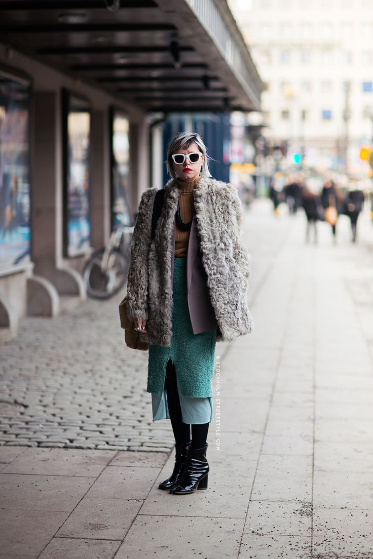 Nicole Walker in a taupe curly lamb shearling coat and fuzzy turquoise pencil skirt.
