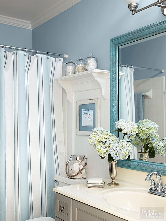 Visions of azure skies dotted with fluffy white clouds, tumbling aquamarine waves, and sandy shorelines drive this beach design. The fresh color scheme gives a buoyant lift to tarnished-silver accessories, a distressed mirror and picture frames, and an antiqued vanity.