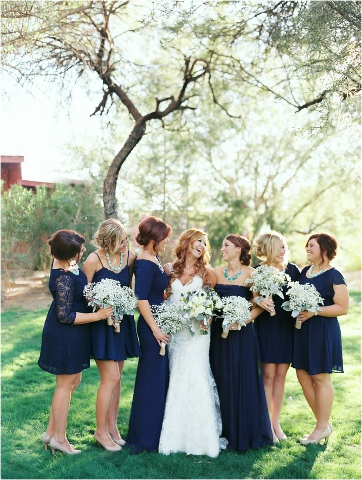 Love this and that all the bridesmaids have different dresses, that way everyone can get one they like