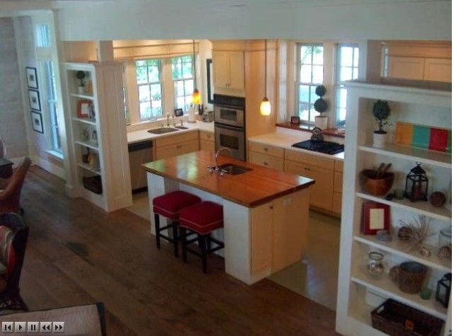 I love how the kitchen opens to the den and yet is still separate.