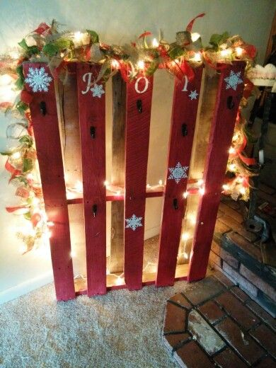 Pallet stocking holder i made, cost less than $20 for paint, string of lights, and burlap tied around the lights