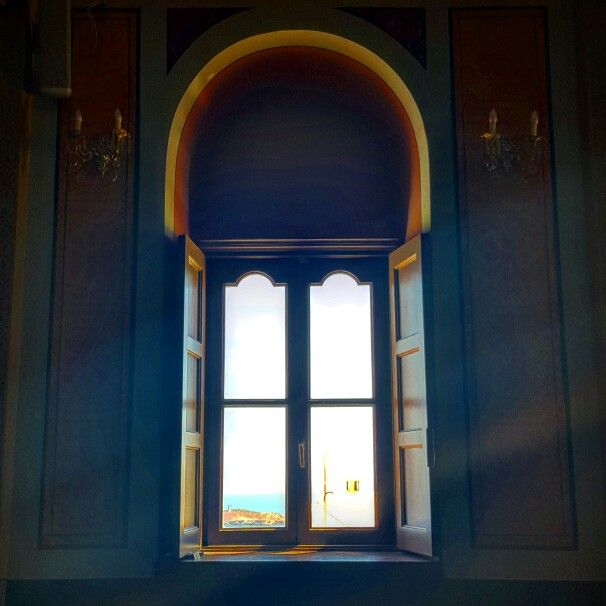 Inside one of the churches at the top of Ermoupolis city.  Little sun glare makes it all the more ethereal.