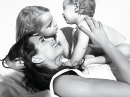 Brooke Shields and daughters Rowan and Grier. posed family photo but a simply beautiful moment between mum and daughters
